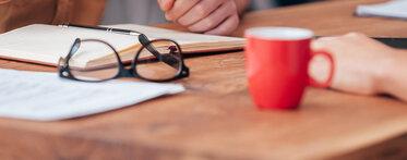 Banner Work Life red mug and glasses