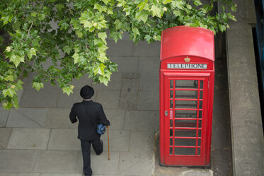 Phone Box with Man in a Bowler Hat