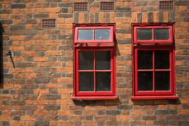 Red window frames red brick walls