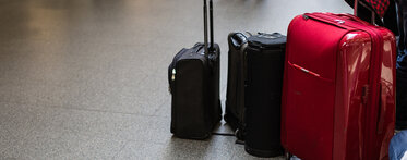Immigration banner suitcases